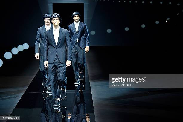 A model walks the runway at the Giorgio Armani show during Milan Men's Fashion Week Spring/Summer 2017 on June 21 2016 in Milan Italy