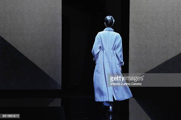 Model walks the runway at the Giorgio Armani show during Milan Men's Fashion Week Fall/Winter 2017/18 on January 17, 2017 in Milan, Italy.
