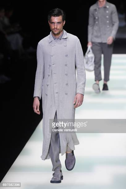 Model walks the runway at the Giorgio Armani show during Milan Men's Fashion Week Spring/Summer 2018 on June 19, 2017 in Milan, Italy.
