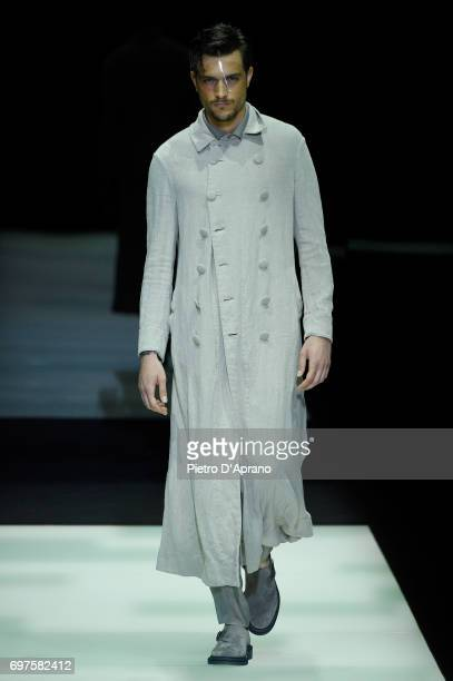 A model walks the runway at the Giorgio Armani show during Milan Men's Fashion Week Spring/Summer 2018 on June 19 2017 in Milan Italy