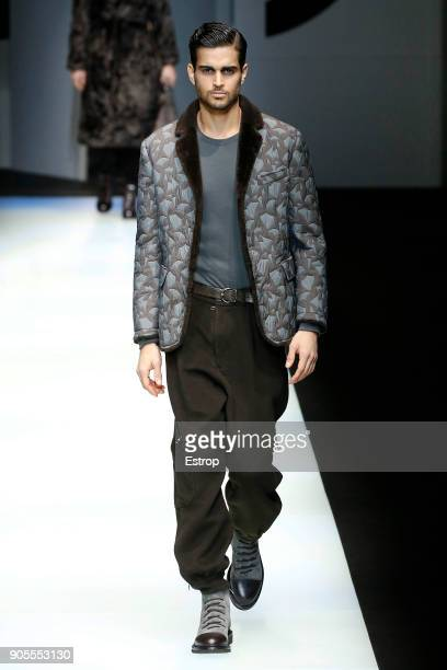 A model walks the runway at the Giorgio Armani show during Milan Men's Fashion Week Fall/Winter 2018/19 on January 15 2018 in Milan Italy