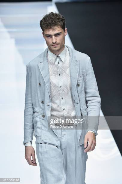 5016d5e49c96 A model walks the runway at the Giorgio Armani show during Milan Men s  Fashion Week Spring