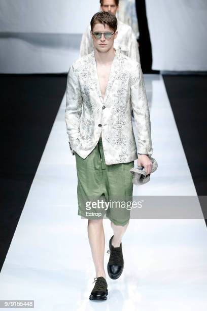 A model walks the runway at the Giorgio Armani show during Milan Men's Fashion Week Spring/Summer 2019 on June 18 2018 in Milan Italy