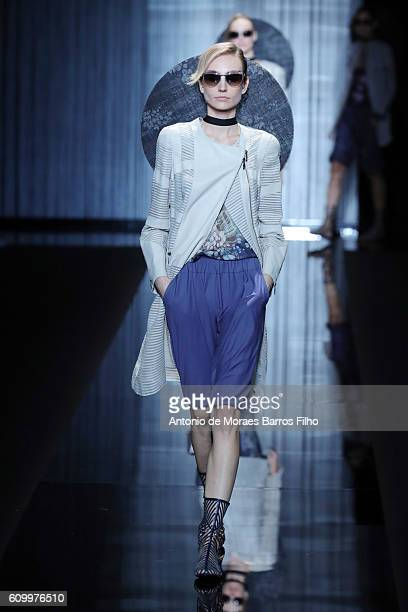 A model walks the runway at the Giorgio Armani show during Milan Fashion Week Spring/Summer 2017 on September 23 2016 in Milan Italy