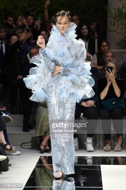 A model walks the runway at the Giorgio Armani show during the Milan Fashion Week Spring/Summer 2020 on September 21 2019 in Milan Italy
