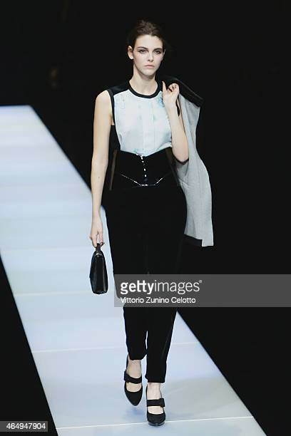 A model walks the runway at the Giorgio Armani show during the Milan Fashion Week Autumn/Winter 2015 on March 2 2015 in Milan Italy