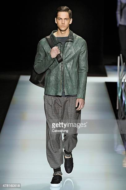 A model walks the runway at the Giorgio Armani Spring Summer 2016 fashion show during Milan Menswear Fashion Week on June 23 2015 in Milan Italy