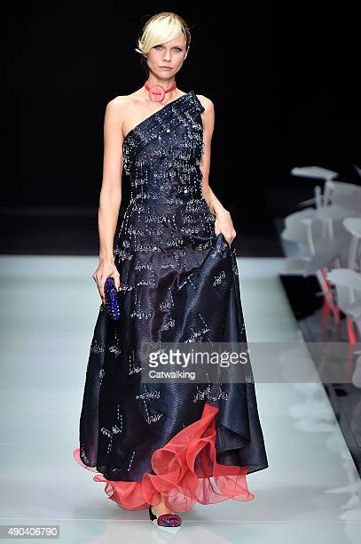 A model walks the runway at the Giorgio Armani Spring Summer 2016 fashion show during Milan Fashion Week on September 28 2015 in Milan Italy