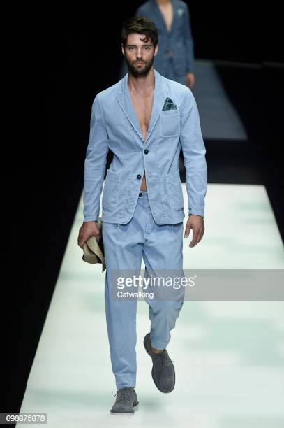c920f3caa0 A model walks the runway at the Giorgio Armani Spring Summer 2018 fashion  show during Milan