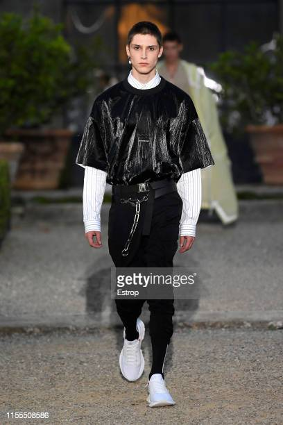 A model walks the runway at the Givenchy fashion show at Villa Palmieri during the Pitti Immagine Uomo 96 on June 12 2019 in Florence Italy