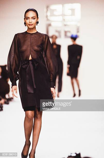 Model walks the runway at the Givenchy Ready to Wear Fall/Winter 1989-1990 fashion show during the Paris Fashion Week in March, 1989 in Paris, France.