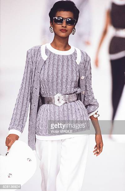 A model walks the runway at the Givenchy Ready to Wear Spring/Summer 1991 fashion show during the Paris Fashion Week in October 1990 in Paris France