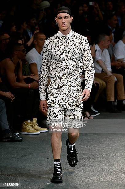 A model walks the runway at the Givenchy Spring Summer 2015 fashion show during Paris Menswear Fashion Week on June 27 2014 in Paris France