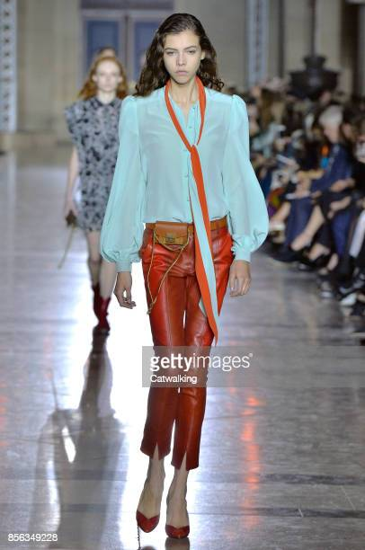 A model walks the runway at the Givenchy Spring Summer 2018 fashion show during Paris Fashion Week on October 1 2017 in Paris France