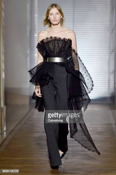 A model walks the runway at the Givenchy Spring Summer 2018 fashion show during Paris Haute Couture Fashion Week on January 23 2018 in Paris France