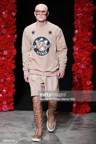 Model walks the runway at the Givenchyshow as part of Paris Menswear Fashion Week Fall/Winter 2011-2012 at Palais Omnisports de Bercy on January 21,...