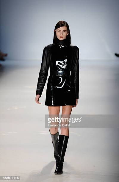 A model walks the runway at the Gloria Coelho fashion show during Sao Paulo Fashion Week Winter 2015 at Parque Candido Portinari on November 6 2014...