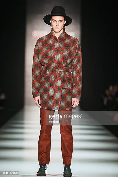 A model walks the runway at the GOGA NIKABADZE show during day 4 of Mercedes Benz Fashion Week Russia Autumn/Winter 2015/16 at Manege on March 29...