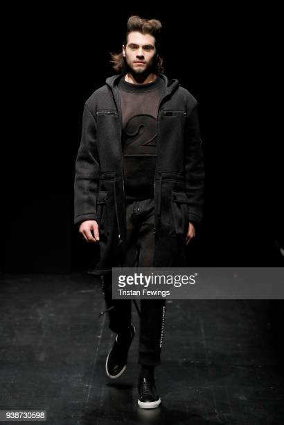 A model walks the runway at the Gokhan Yavas show during MercedesBenz Fashion Week Istanbul at the Zorlu Performance Hall on March 27 2018 in...