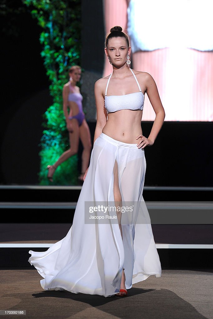 A model walks the runway at the Goldenpoint fashion show during Glamour Live Show on June 11, 2013 in Milan, Italy.