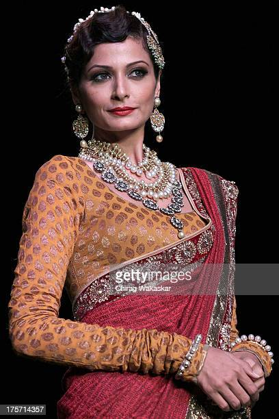 Model walks the runway at the Golecha's Jewels show on day 3 of India International Jewellery Week 2013 at the Hotel Grand Hyatt on August 6, 2013 in...