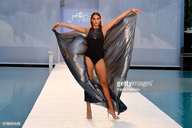Model walks the runway at the Gottex Cruise 2017 at SwimMiami - Runway at W South Beach on July 16, 2016 in Miami Beach, Florida.