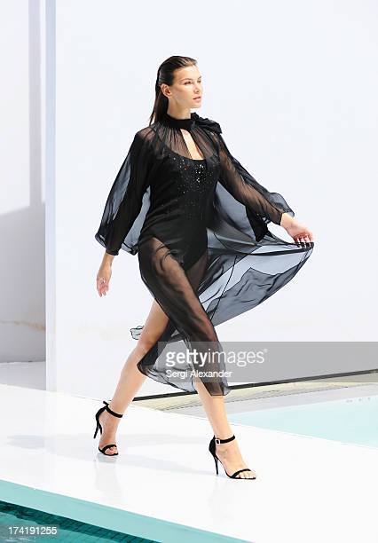 A model walks the runway at the Gottex show during MercedesBenz Fashion Week Swim 2014 at the SLS Hotel on July 21 2013 in Miami Florida