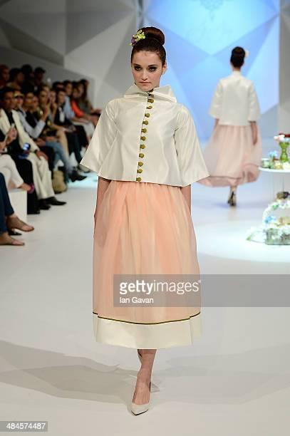A model walks the runway at the Grazia Emerging Designer show during Fashion Forward at Madinat Jumeirah on April 13 2014 in Dubai United Arab...