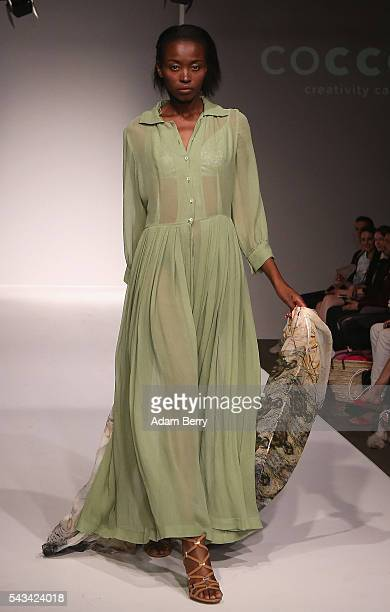 A model walks the runway at the Green Showroom show during the MercedesBenz Fashion Week Berlin Spring/Summer 2017 at Postbahnhof on June 28 2016 in...