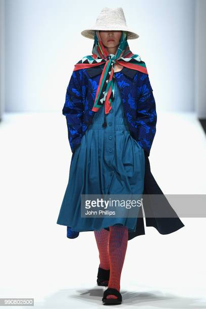 A model walks the runway at the Greenshowroom Selected show during the Berlin Fashion Week Spring/Summer 2019 at ewerk on July 3 2018 in Berlin...
