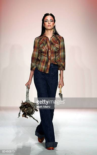 A model walks the runway at the Grey Ant Fall 2005 show during MercedesBenz Fashion Week at Smashbox Studios March 18 2005 in Culver City California