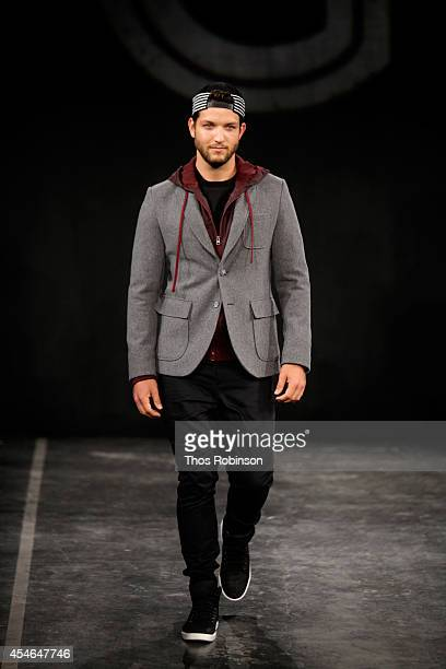 A model walks the runway at the Grungy Gentleman Presentation during MercedesBenz Fashion Week Spring 2015 at The Hub at The Hudson Hotel on...