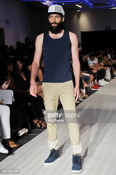 A model walks the runway at the Grungy Gentleman show during New York Fashion Week Men's S/S 2017 at The W Hotel on July 14 2016 in New York City
