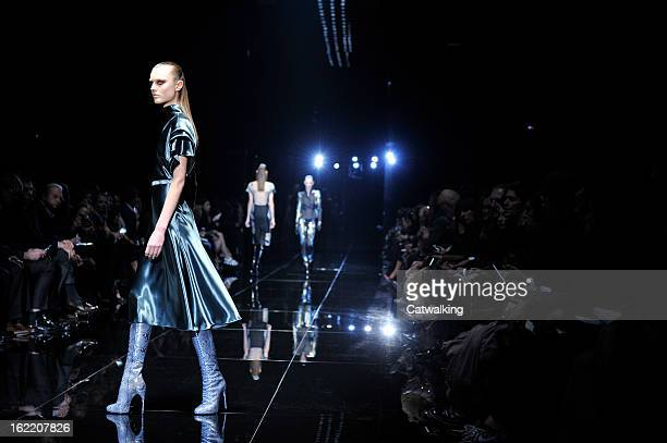 A model walks the runway at the Gucci Autumn Winter 2013 fashion show during Milan Fashion Week on February 20 2013 in Milan Italy