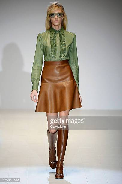 A model walks the runway at the Gucci Autumn Winter 2014 fashion show during Milan Fashion Week on February 19 2014 in Milan Italy