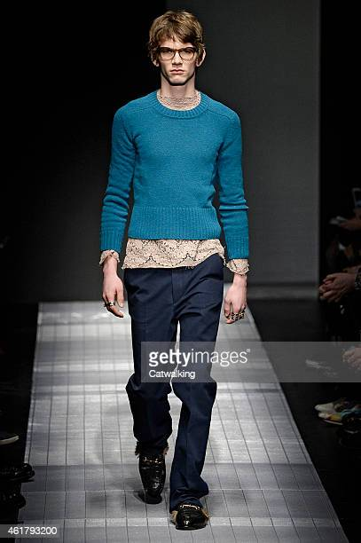A model walks the runway at the Gucci Autumn Winter 2015 fashion show during Milan Menswear Fashion Week on January 19 2015 in Milan Italy