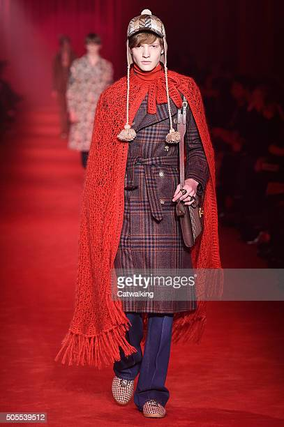 A model walks the runway at the Gucci Autumn Winter 2016 fashion show during Milan Menswear Fashion Week on January 18 2016 in Milan Italy