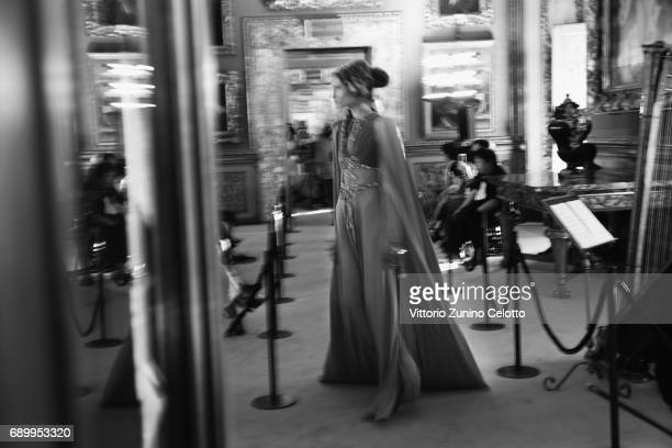 A model walks the runway at the Gucci Cruise 2018 show at Palazzo Pitti on May 29 2017 in Florence Italy
