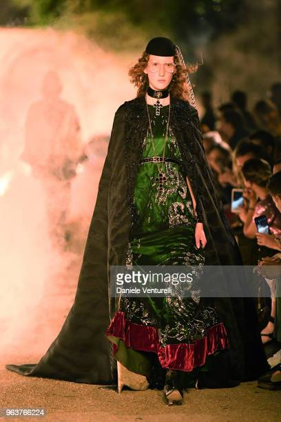 A model walks the runway at the Gucci Cruise 2019 show at Alyscamps on May 30 2018 in Arles France
