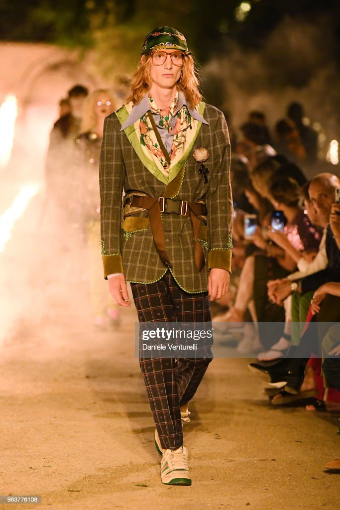 65f670d8e92 A model walks the runway at the Gucci Cruise 2019 show at Alyscamps ...
