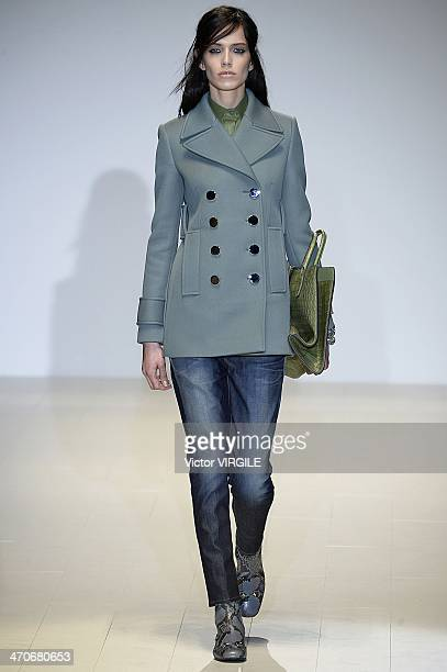 A model walks the runway at the Gucci Ready to Wear Fall/Winter 20142015 Show during Milan Fashion Week Womenswear Autumn/Winter 2014 on February 19...