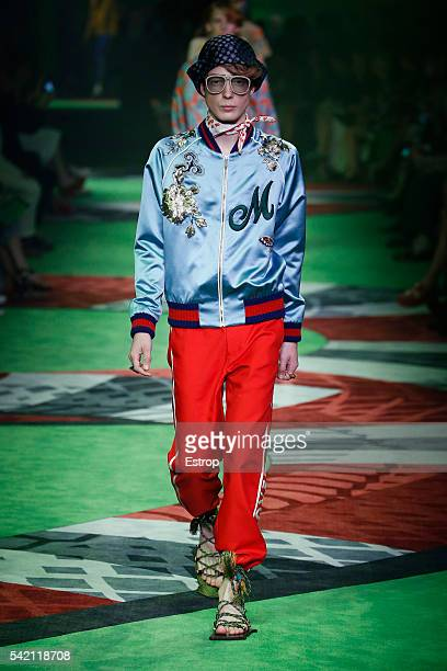 A model walks the runway at the Gucci show designed by Alessandro Michele during Milan Men's Fashion Week SS17 on June 20 2016 in Milan Italy