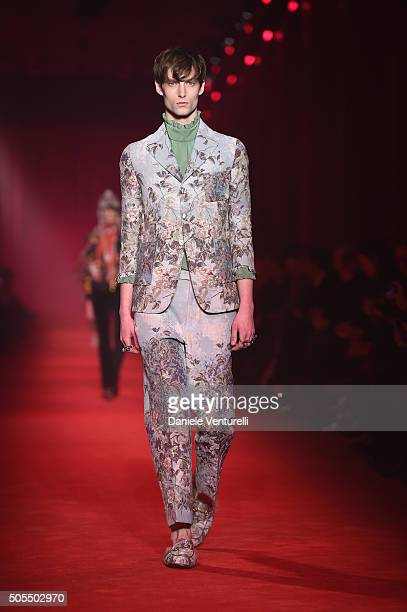 Model walks the runway at the Gucci show during Milan Men's Fashion Week Fall/Winter 2016/17 on January 18 2016 in Milan Italy