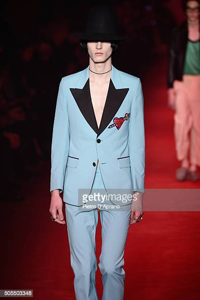 A model walks the runway at the Gucci show during Milan Men's Fashion Week Fall/Winter 2016/17 on January 18 2016 in Milan Italy