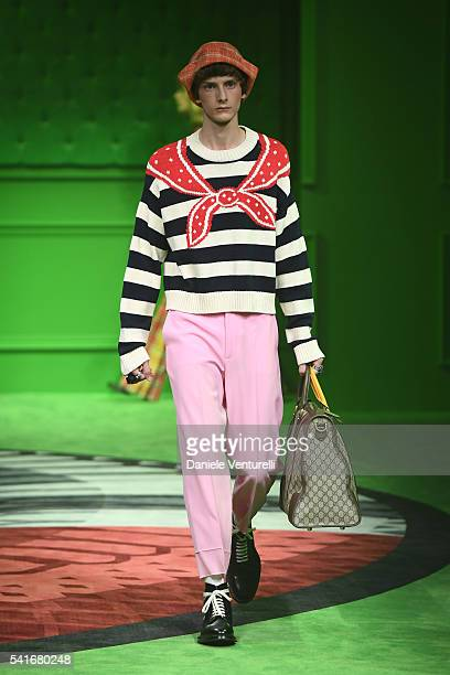 A model walks the runway at the Gucci show during Milan Men's Fashion Week SS17 on June 20 2016 in Milan Italy