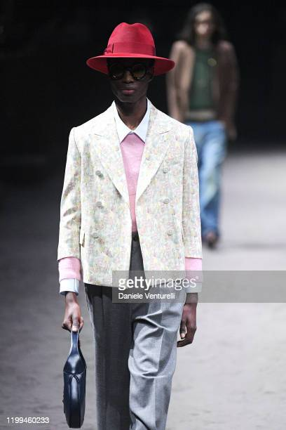 Model walks the runway at the Gucci show during Milan Menswear Fashion Week Fall/Winter 2020/21 on January 14, 2020 in Milan, Italy.