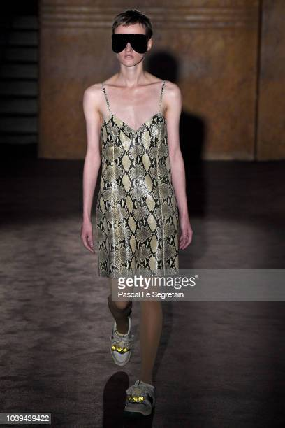 A model walks the runway at the Gucci show during Paris Fashion Week Spring/Summer 2019 on September 24 2018 in Paris France