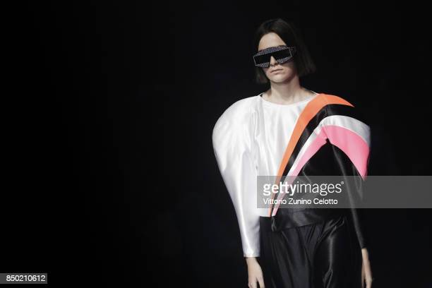 A model walks the runway at the Gucci show during the Milan Fashion Week Spring/Summer 2018 on September 20 2017 in Milan Italy
