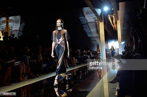 A model walks the runway at the Gucci Spring Summer 2014 fashion show during Milan Fashion Week on September 18 2013 in Milan Italy