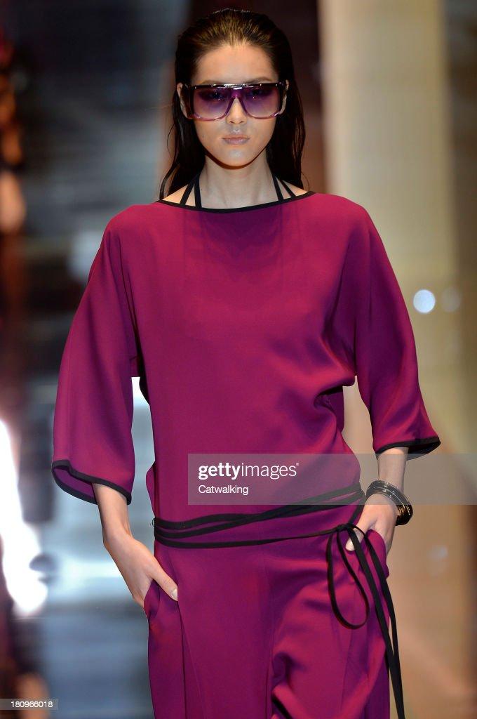 942fc650c1d4b A model walks the runway at the Gucci Spring Summer 2014 fashion ...
